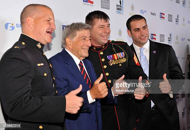 """Tony Bennett poses with United States servicemen at """"Stand Up for Heroes"""" at the Beacon Theatre on November 3, 2010 in New York City."""