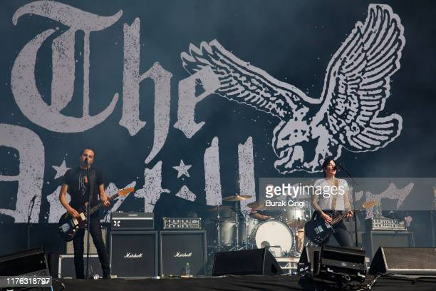 Tony Bevilacqua Andy Granelli and Brody Dalle of The Distillers perform live on the Main Stage during day three of Reading Festival 2019 at Richfield...