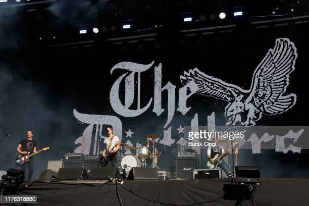 Tony Bevilacqua Brody Dalle and Ryan Sinn of The Distillers perform live on the Main Stage during day three of Reading Festival 2019 at Richfield...