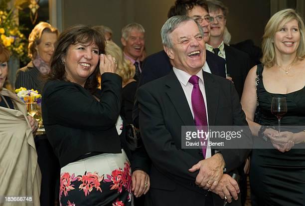 Tony Blackburn and Debbie Blackburn attend Nicholas Parsons 90th birthday party at the Churchill Hotel on October 8 2013 in London England