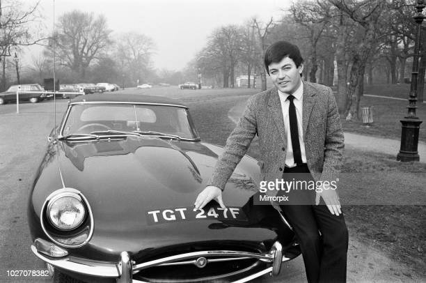 Tony Blackburn, Radio One disc jockey, pictured in Hyde Park, London. He is seen with his new E-Type Jaguar - the registration number is the same as...
