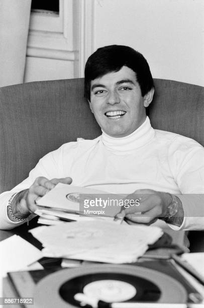 Tony Blackburn the 22 year old Disc Jockey at his flat in Knightsbridge London relaxing with his records Tony Blackburn recently launched BBC Radio...