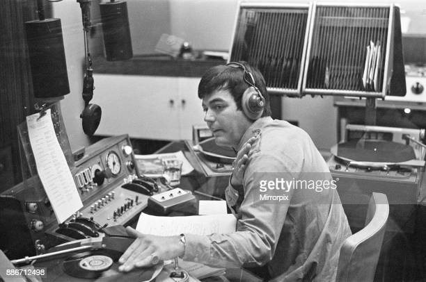 Tony Blackburn the 22 year old Disc Jockey during his broadcast of the very first show on BBC Radio One Here Tony queues up the first disc he will...