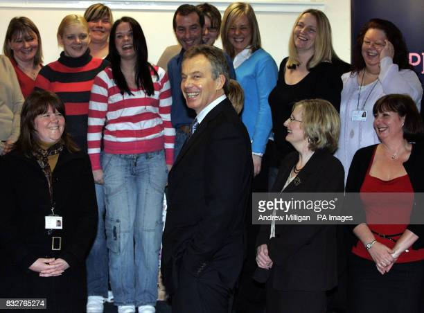 Tony Blair after having his photograph taken with The Stepping Stones for Families Childcare Works group at the Glenburnie Centre in Glasgow The...