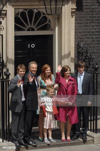Tony Blair and his family wave to the press just before their final departure from 10 Downing Street on the day that he steps down as Prime Minister...