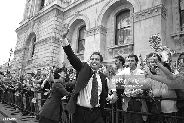 Tony Blair and his wife Cherie celebrating with supporters on Downing Street after his successful 1997 General Election campaign to become Britain's...