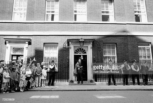 Tony Blair and wife Cherie Blair on the steps of Number 10 Downing Street on the first day of residence after his landslide election victory.