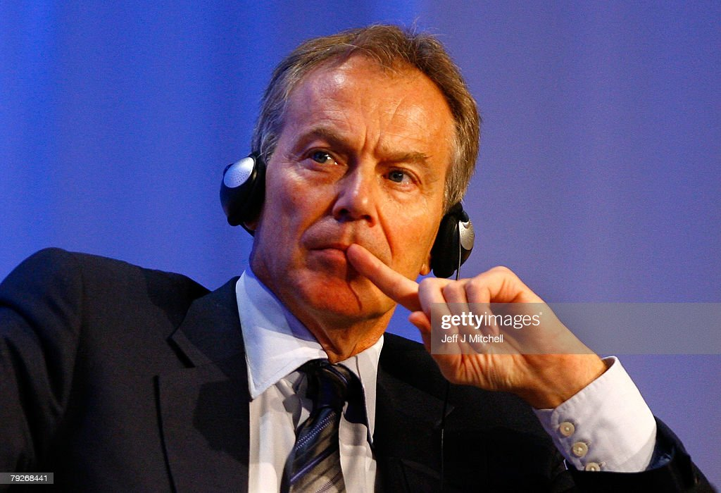 Tony Blair, former British Prime Minister and current UN Middle East envoy, listens to a speech by Yasuo Fukuda, Prime Minister of Japan, at the World Economic Forum January 26, 2008 in Davos, Switzerland. Some of the World's top business people, heads of state and representatives of NGOs will meet at the forum until Sunday.