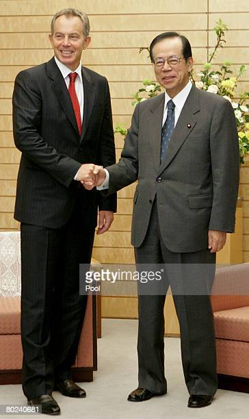 Tony Blair former British Prime Minister talks with Japanese Prime Minister Yasuo Fukuda during their meeting on March 14 2008 at the Prime...