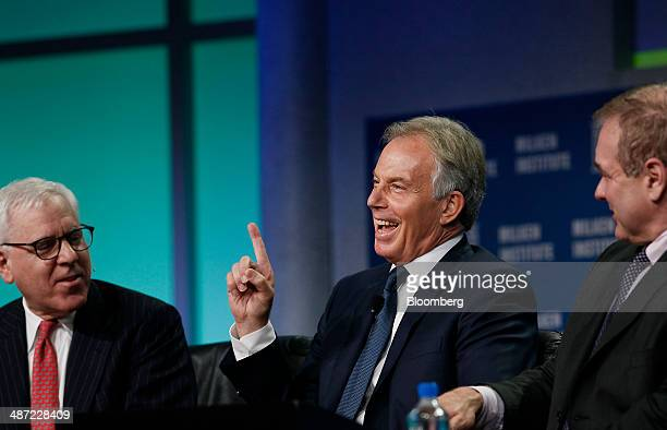 Tony Blair former UK prime minister center speaks while David Rubenstein cofounder and cochief executive officer of the Carlyle Group LP left and...