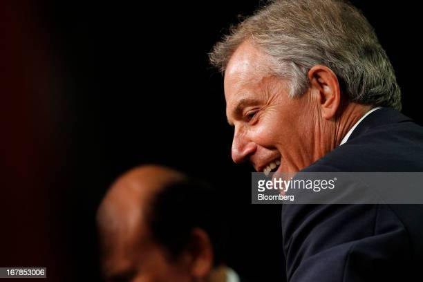Tony Blair former UK prime minister right laughs during an interview with Michael Milken chairman of the Milken Institute at the Milken Institute...