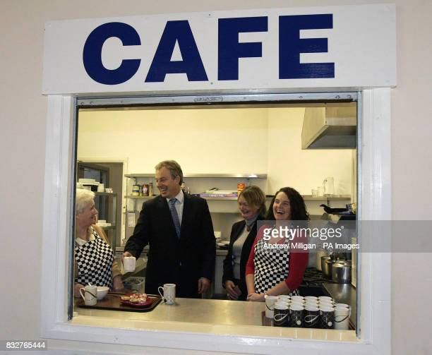 Tony Blair helps with the tea during his meeting with The Stepping Stones for Families Childcare Works group at the Glenburnie Centre in Glasgow The...