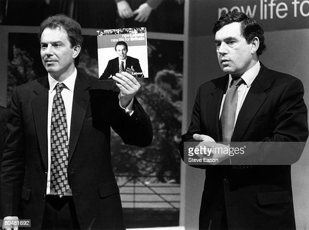 Tony Blair leader of the Labour party holds up his new manifesto July 1996 With him is Gordon Brown shadow Chancellor of the Exchequer