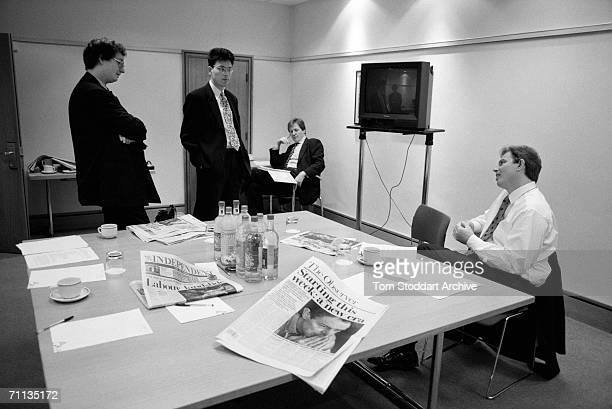 Tony Blair MP with his aides including Alastair Campbell and David Miliband in the background three days before his successful 1997 General Election...