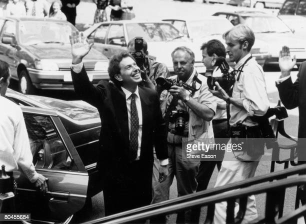 Tony Blair waves to wellwishers after his election as leader of the Labour Party and is photographed by journalists 21st July 1994