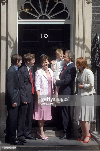 Tony Blair with his family on the doorstep of 10 Ten Downing Street LR sons Nicky Euan wife Cherie son Leo Tony Blair and daughter Kathryn The family...