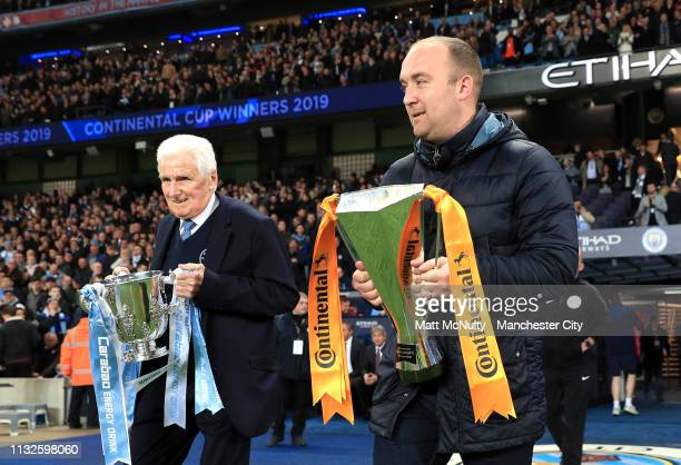 Tony Book Ex Manchester City player walks out with Carabao Cup Trophy as Nick Cushing Manchester City Women manager walks out with the Continental...