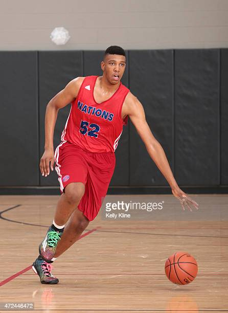 Tony Bradley in red brings the ball up the court during Adidas Nations Atlanta on May 2 2015 at North Atlanta High School in Atlanta Georgia