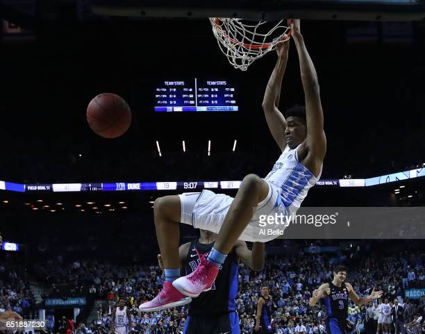 Tony Bradley of the North Carolina Tar Heels dunks against Duke Blue Devils during the Semi Finals of the ACC Basketball Tournament at the Barclays...