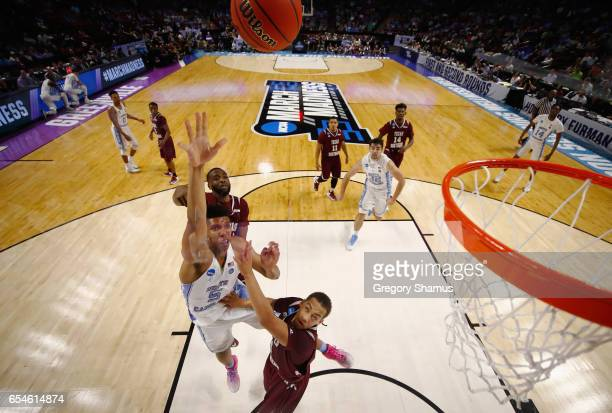 Tony Bradley of the North Carolina Tar Heels shoots against Kevin Scott of the Texas Southern Tigers in the second half during the first round of the...