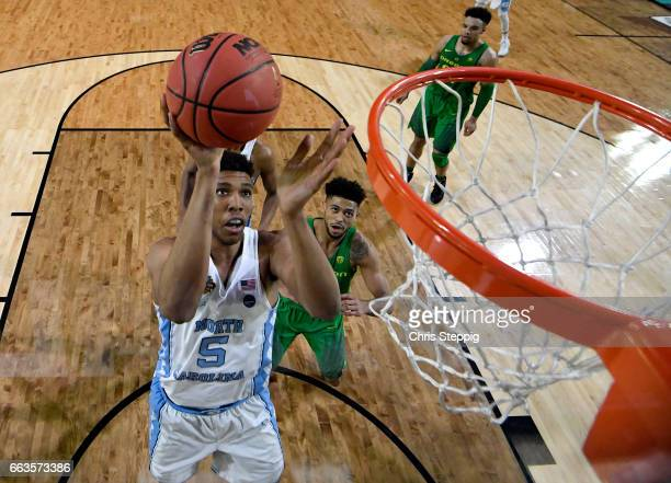Tony Bradley of the North Carolina Tar Heels shoots the ball during the 2017 NCAA Men's Final Four Semifinal against the Oregon Ducks at University...
