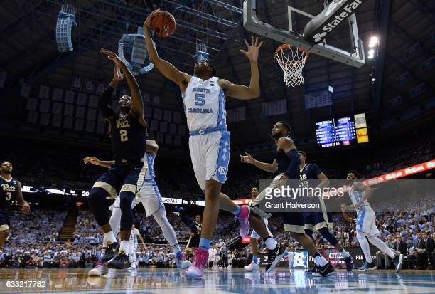 Tony Bradley of the North Carolina Tar Heels tips a rebond away from Michael Young of the Pittsburgh Panthers during the game at the Dean Smith...