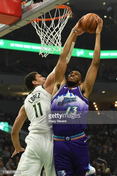 Tony Bradley of the Utah Jazz is defended by Brook Lopez of the Milwaukee Bucks during the first half at Fiserv Forum on November 25 2019 in...