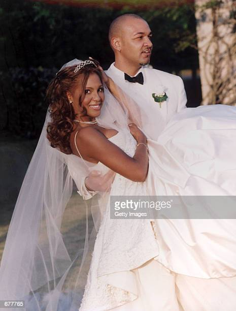 Tony Braxton and her husband Keri Lewis keyboardist for the band Mint Condition kid around on their wedding day April 21 2001 in Alpharetta GA The...