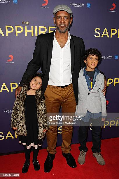 Tony Briggs and his children Soraya Briggs and Carlin Briggs pose on the red carpet at the Sydney Premiere of The Sapphires at State Theatre on...