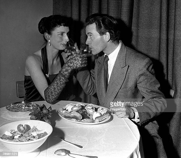 1953 Tony Britton is pictured having a meal with his wife