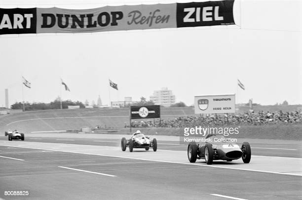 Tony Brooks in the the Ferrari 246/F1 followed closely by the Cooper of Masten Gregory on the main straight during the German Grand Prix at Avus 2nd...
