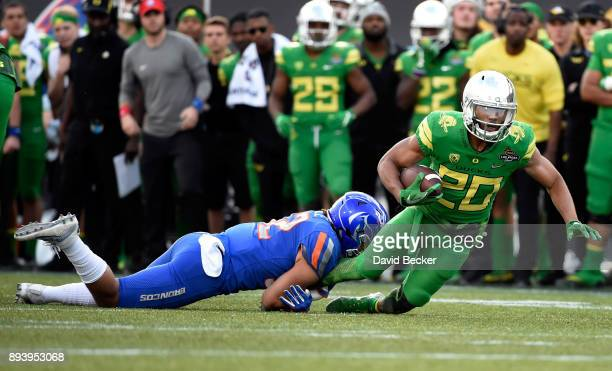 Tony BrooksJames of the Oregon Ducks is tackled by Jordan Happle of the Boise State Broncos during the Las Vegas Bowl at Sam Boyd Stadium on December...