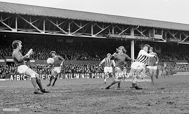 Tony Brown beats Manchester United defender John Fitzpatrick and goalkeeper Alex Stepney to score for West Bromwich Albion during their 1st Division...