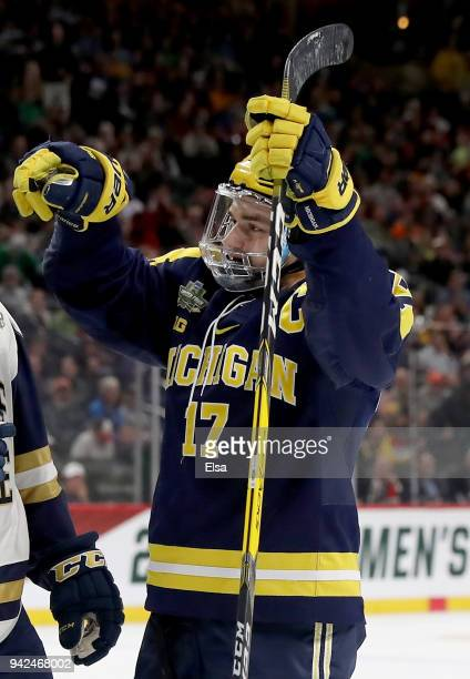 Tony Calderone of the Michigan Wolverines celebrates his goal in the first period against the Notre Dame Fighting Irish during the semifinals of the...