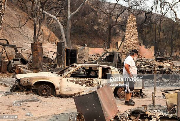 Tony Cambria looks through the charred remains of his friends home that was burned by the Station Fire September 2 2009 at Vogel Flats near Tujunga...