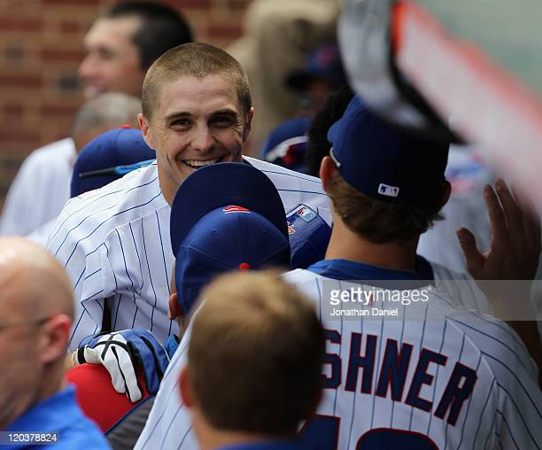 Tony Campana of the Chicago Cubs is lifted by Carlos Zambrano in the dugout after hitting an inside-the-park, two-run home run in the 1st inning...
