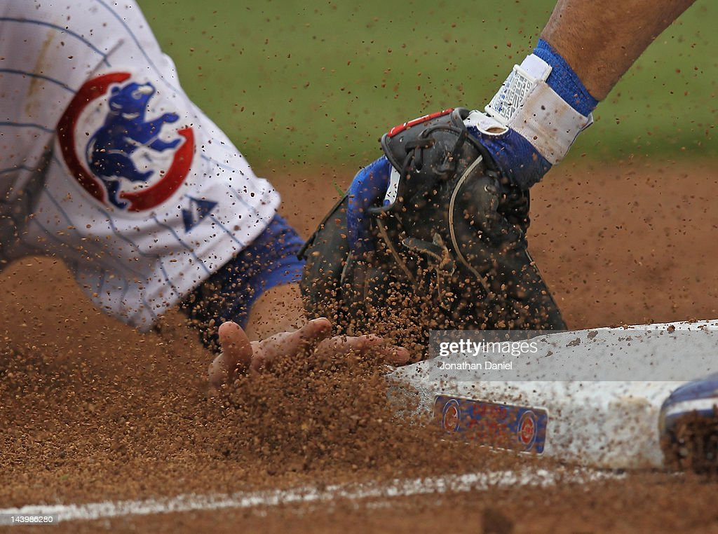 Tony Campana #1 of the Chicago Cubs is tagged out trying to steal third base by Adam Kennedy #3 of the Los Angeles Dodgers at Wrigley Field on May 6, 2012 in Chicago, Illinois. The Cubs defeated the Dodgers 4-3 in 11 innings.