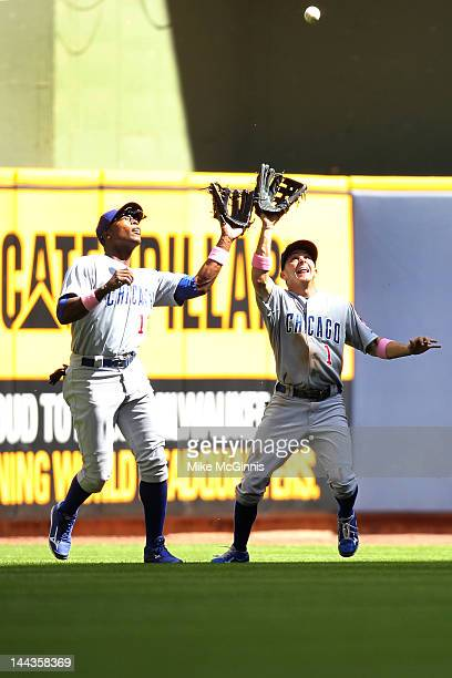 Tony Campana of the Chicago Cubs makes the catch in leftcenter field before colliding with Alfonso Soriano in the game against the Milwaukee Brewers...