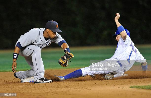 Tony Campana of the Chicago Cubs steals second base as Ramon Santiago of the Detroit Tigers makes a late tag in the seventh inning on June 12 2012 at...