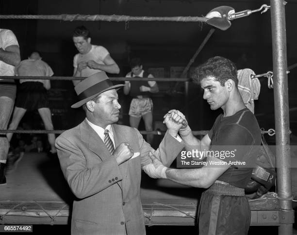 Tony Canzoneri and Jimmy Cerello pose for a portrait in Stillman's Gym New York New York 1952