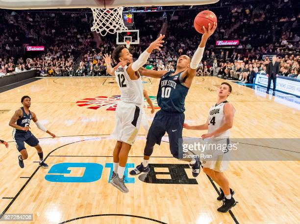 Tony Carr of the Penn State Nittany Lions is defended by Vincent Edwards of the Purdue Boilermakers during the semifinals of the Big Ten Basketball...