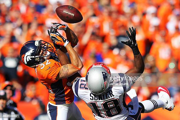 Tony Carter of the Denver Broncos breaks up a pass intended for Matthew Slater of the New England Patriots in the first quarter during the AFC...