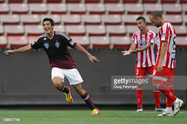 Tony Cascio of the Colorado Rapids celebrates his goal in the first half as Kristian Konstantinidis and Jason Trifiro of the Melbourne Heart FC look...