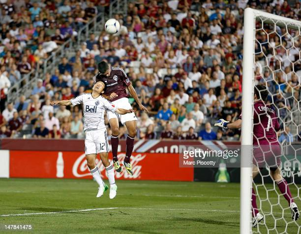 Tony Cascio of the Colorado Rapids tries to redirect the ball towards the net in front of Lee YoungPyo of the Vancouver Whitecaps FC during their...