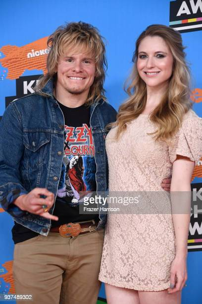 Tony Cavalero and Annie Cavalero attend Nickelodeon's 2018 Kids' Choice Awards at The Forum on March 24 2018 in Inglewood California
