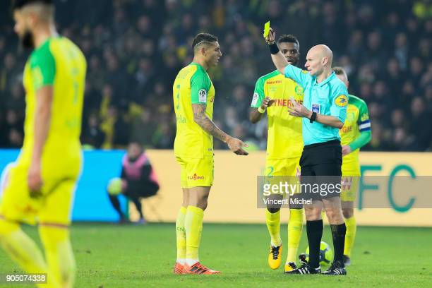 Tony Chapron referee and Diego Carlos of Nantes during the Ligue 1 match between FC Nantes and Paris Saint Germain at Stade de la Beaujoire on...