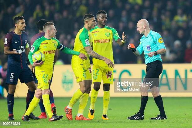 Tony Chapron referee and Valentin Rongier Diego Carlos of Nantes during the Ligue 1 match between FC Nantes and Paris Saint Germain at Stade de la...