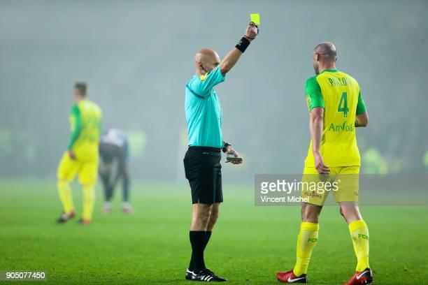 Tony Chapron referee give a yellow card Nicolas Pallois of Nantes during the Ligue 1 match between FC Nantes and Paris Saint Germain at Stade de la...