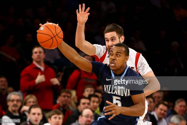 Tony Chennault of the Villanova Wildcats attempts to control the ball in the first half against Luke Hancock of the Louisville Cardinals during the...