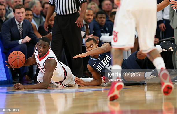 Tony Chennault of the Villanova Wildcats reaches for the ball against Sir'Dominic Pointer of the St John's Red Storm during the game at Madison...